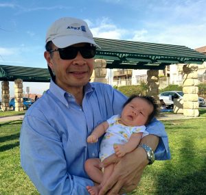 Arnold Ng with grandchild